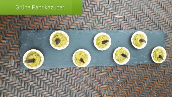 Party cups with green Ajvar